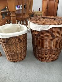 2 Wicker Lined Laundry Baskets. Large one has Lid and is 20 inches tall. Smaller one is 17 inches tall. Lining is removable and each basket has Handles. Great condition.  Cochrane, T4C 1K6