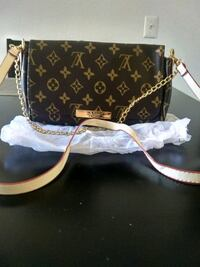 black and brown Louis Vuitton leather crossbody bag Las Vegas, 89117