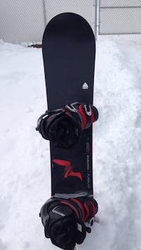 Black and red snowboard with bindings Edmonton, T5S 2C6