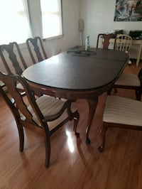 round brown wooden table with six dining chairs  Providence, 02908