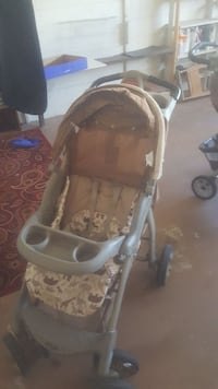 brown and black umbrella stroller Kissimmee, 34741