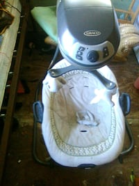 baby's white and gray Graco cradle and swing 679 mi