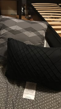 two black and gray throw pillows