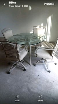 Glass table and 4chairs on wheels