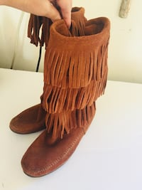 women's pair of brown fringe boots