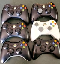four assorted Xbox 360 controllers Thomson, 30824