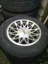 4 inspected tires with Lincoln town car rims.