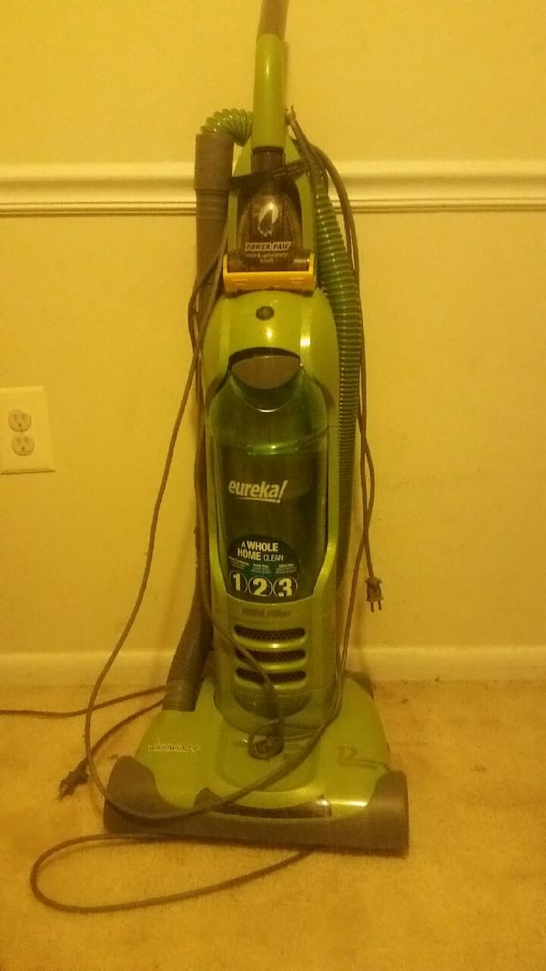 blue and gray Eureka upright vacuum cleaner 87cd3556-fe7d-4cbc-8bcb-8adc62911077