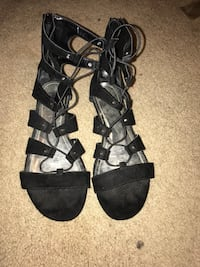 pair of black open-toe strappy sandals Midlothian, 76065