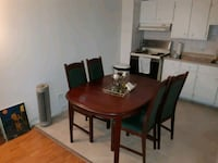 round brown wooden table with four chairs dining set Montréal, H4N