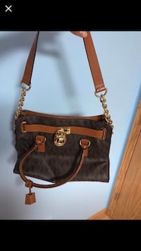 a2d9bac8b045 Used brown and black Michael Kors leather 2-way bag for sale in ...