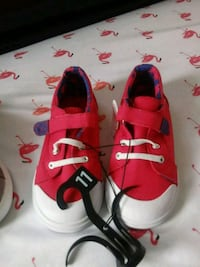 pair of red-and-white Nike sneakers Champaign, 61822