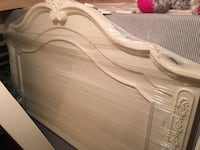 White double wooden sleigh bed  Niagara-on-the-Lake, L0S