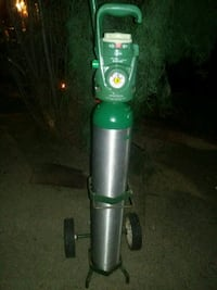 PRAXAIR GRAB N GO OXYGEN TANK WITH CART 2231 mi