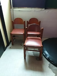4 brown wooden framed leather padded armchair