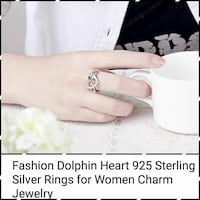 silver-colored dolphin and heart ring 624 mi
