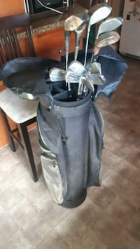 Assorted wedges & drivers & a putter some new, done classic. Edmonton, T5G 2A5