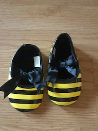 pair of girl's black-and-yellow striped shoes Austin