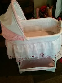 baby's white and pink bassinet