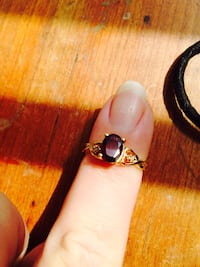 Gold-colored purple gemstone ring