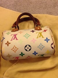 white and brown leather Louis Vuitton tote bag Vaughan