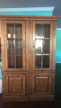 Brown wooden framed glass display cabinet Houston, 77013