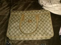 brown and white monogrammed Michael Kors leather tote bag 60 mi