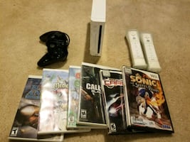 Complete Wii System with Two Wii Remotes, COD Controller, and Games