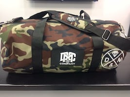 Brown and green company camouflage duffle bag