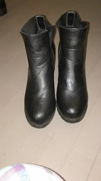 Black leather and stretchy materialhigh heel boots
