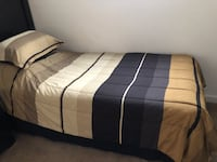 Twin size comforter and pillow sham with black bed skirt!  Nice.