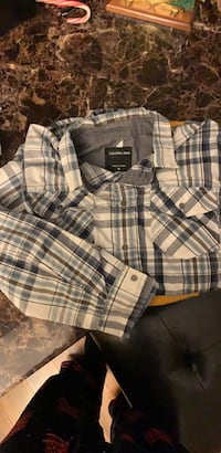 White and blue plaid button up dress shirt. CK jeans brand Alexandria, 22303