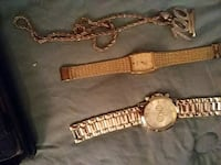 gold-colored analog watch with link bracelet 291 mi