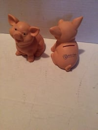 Two old piggy banks . Collectors pieces .
