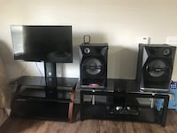 black flat screen TV and black wooden TV stand Austin, 78660