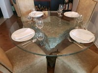 round clear glass top table with gray metal base Toronto, M3J 2T6