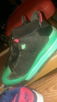 pair of black-and-green Nike basketball shoes Laurinburg, 28352