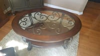 48 x 34 Oval coffee table by Ashley furniture