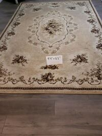 Area rug, 9 feet 4 inches x 6 feet 6 inches. Toronto, M9R 3N8