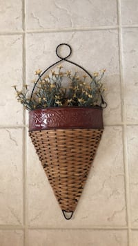 Basket/wire frame wall hanging.  Can remove flowers and leave empty Indianapolis, 46227