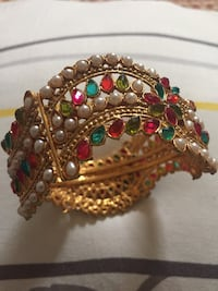 Beaded gold-colored pin. Indian hand made.