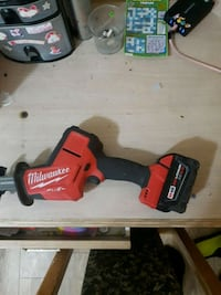 red and black Milwaukee cordless power drill Surrey, V3T 1X1
