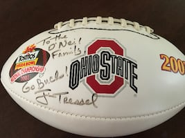 Autographed OSU football. Signed by Coach Jim Tressel