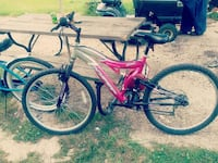 pink and grey full suspension mountain bike