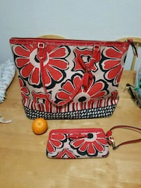 Red flowered coach bag and matching wristlet Nampa, 83686