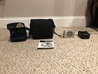 Polaroid Camera w/ owner manual and carrying bag, cannon digital