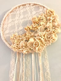 Hand Made Greek Doily Wall Art-all flowers made of Greek doilies $50. Pick up on Hutchinson Island Fort Pierce, 34949