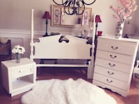 white wooden headboard tallboy dresser and side table
