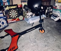 Black and brown powerwing scissor scooter