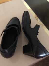 pair of black leather pointed-toe pumps Delray Beach, 33445